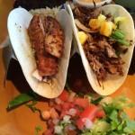 Fish and carnitas tacos