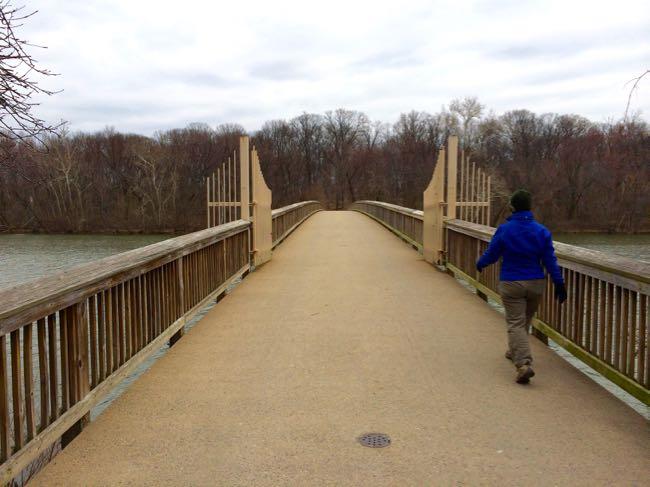 Cross the footbridge to begin a Theodore Roosevelt Island hike