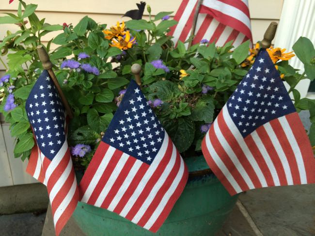 American flags in planter