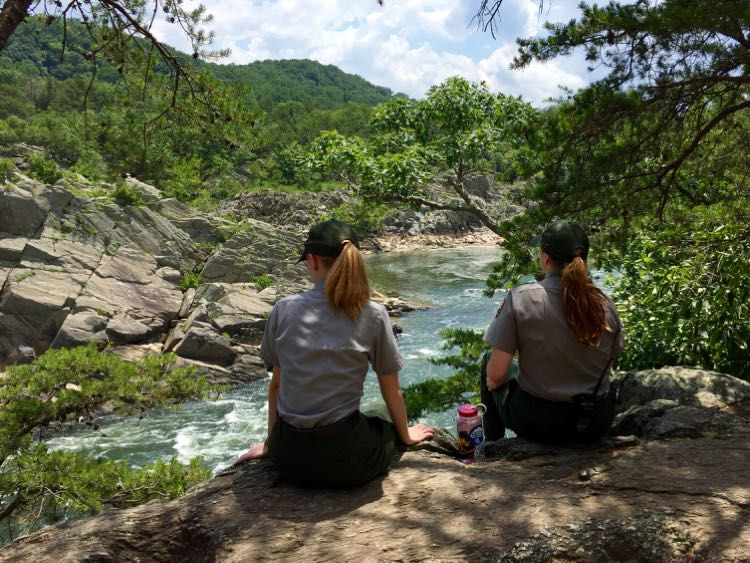 Rangers enjoy the view from the Mather Gorge Overlook on the Great Falls River Trail