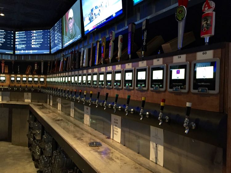 Beer taps line the wall at Draft Taproom in downtown Cville