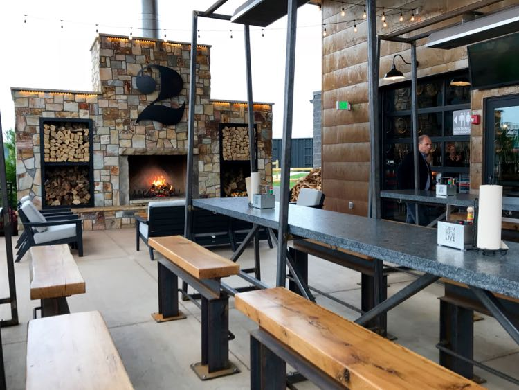Patio fireplace and seating outside the Pour House