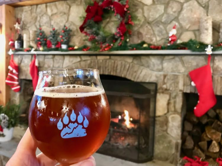Bear Chase Brewing holiday toast by the fireplace in Bluemont VA