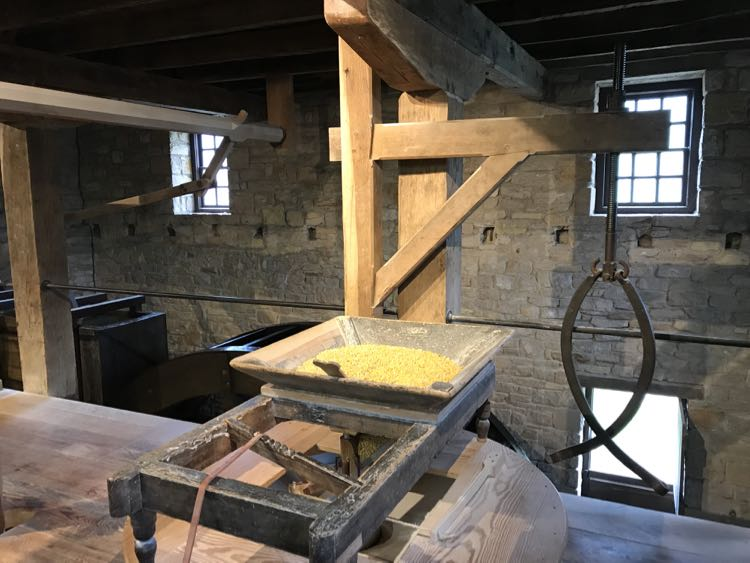 Milling corn Washington's Distillery and Gristmill