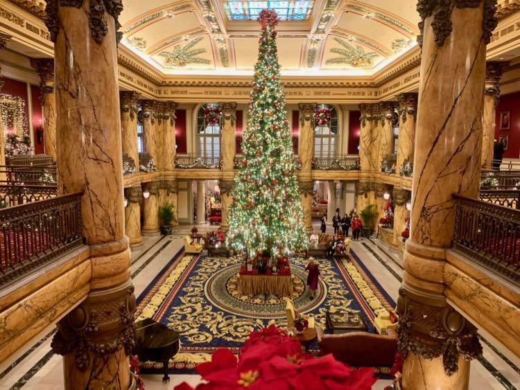 Giant Christmas tree and holiday decorations in the Rotunda lobby Richmond VA