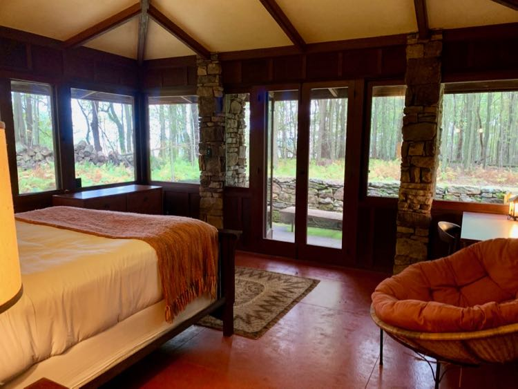 This Balter House bedroom offers views and access to the outdoors