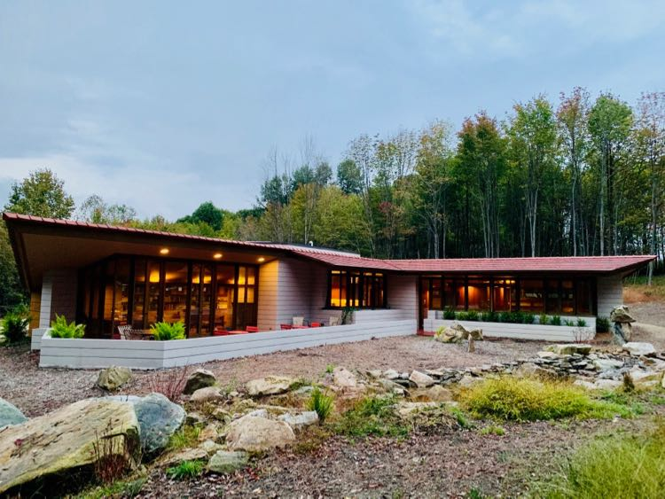 A wall of windows opens to nature at Mantyla House in Acme PA