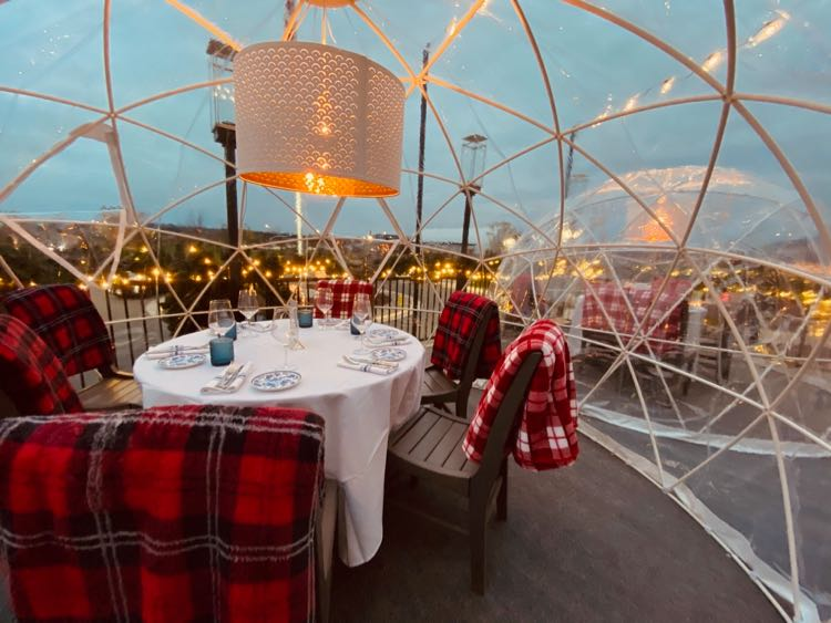 Heated outdoor dining and drinking igloo, photo by Farm Brew Live